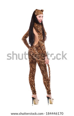 Smiling young woman in leopard suit. Isolated on white