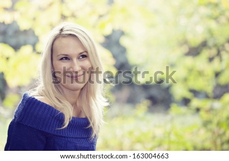 Smiling young woman in the park