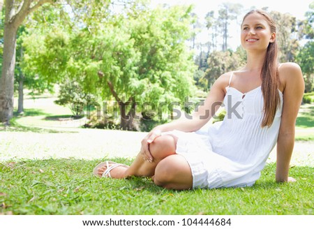 Smiling young woman relaxing on the grass