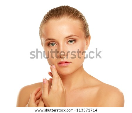 Smiling young woman's face with points of cream - stock photo