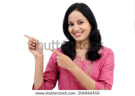 Smiling young woman showing isolated presentation against white