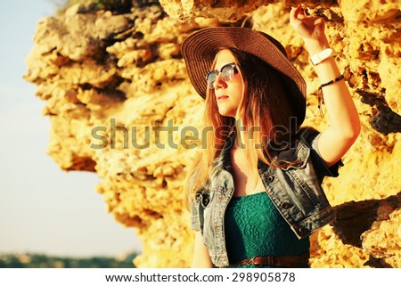 smiling young woman wearing boho style clothes enjoy in summer day on the beach, retro colors - stock photo