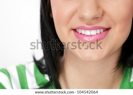smiling young woman with beautiful teeth - stock photo