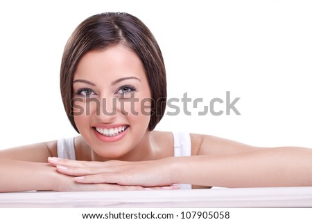 Smiling young woman with clear fresh skin - stock photo