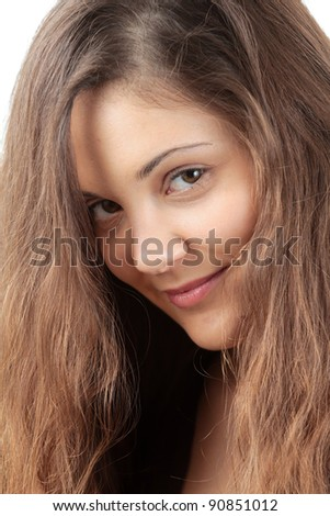 Smiling young woman with curly hair - stock photo
