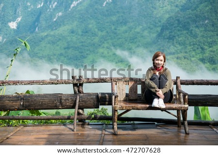 Smiling young woman  With  Doi Luang Chiang Dao Montains Background ( Chiang Mai Province, Thailand )