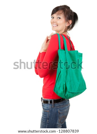 smiling young woman with green ecological shopping bag, white background