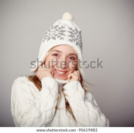 smiling young woman with jumper and winter cap