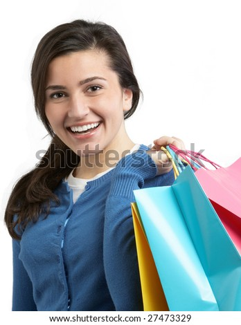 Smiling young woman with shopping bags on white