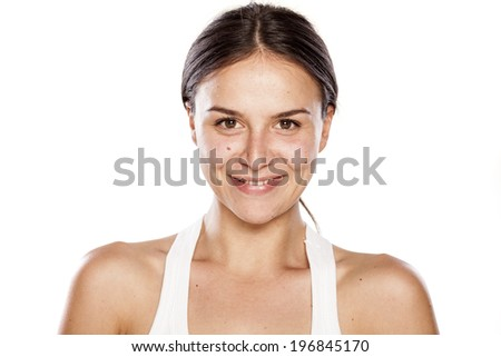 smiling young woman without make-up - stock photo
