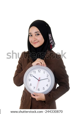 Smiling young women holding the watch  - stock photo
