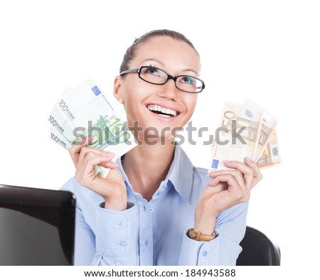Smilling businesswoman on workplace with euros in hands  - stock photo
