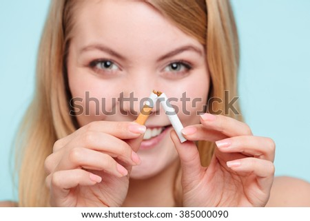 Smilling pretty girl breake down cigarette. Winning with addicted nicotine problems in young age. Quitting from addiction concept. - stock photo