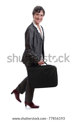 smimling mature businesswoman walking with laptop case isolated on white background - stock photo
