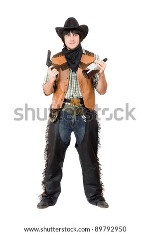 Smirking cowboy with a gun and bottle of whiskey in hands