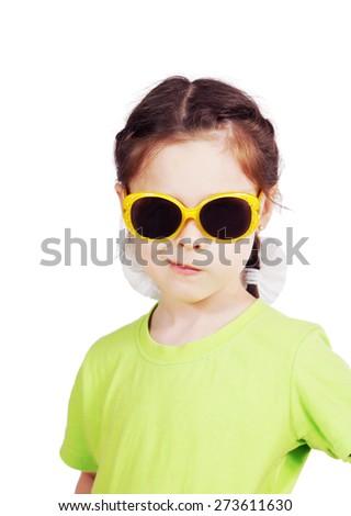 Smirking cute little girl with sunglasses - stock photo