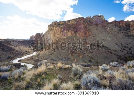 Smith Rock State Park and the Crooked River during the daytime in the Winter. This is a great time to do some rock climbing as the sun doesn't make the rocks too hot to hold onto. - stock photo