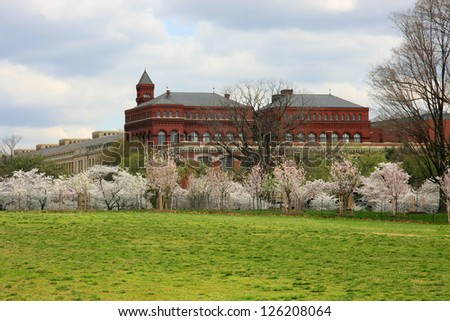 Smithsonian institute in Cherry blossoms - stock photo
