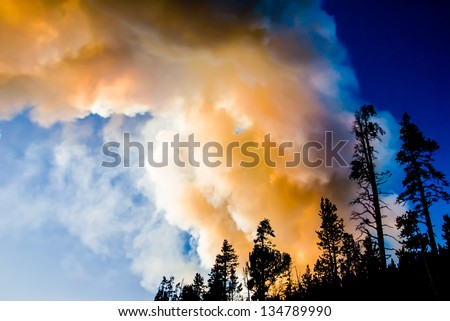 Smoke and flame bellow from the Antelope Creek wildfire in Yellowstone Park - stock photo