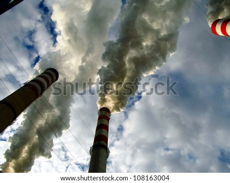 smoke and steam from the high chimney power plant - stock photo