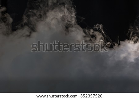 Smoke cloud over black background