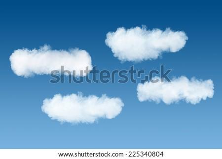 smoke clouds on blue sky background - stock photo