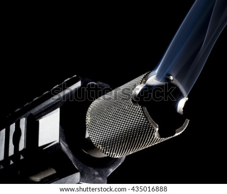 Smoke coming from the barrel of a semi automatic firearm - stock photo