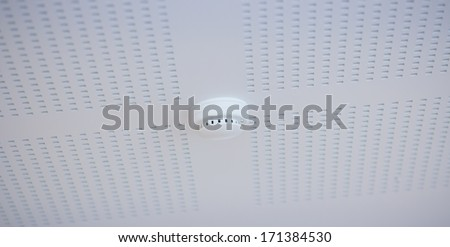 Smoke detector sticking on the ceiling. - stock photo