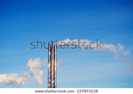 Smoke from a steel pipe manufacturing or boiler - stock photo