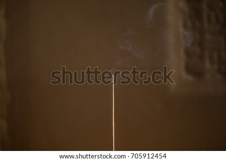 Smoke from aroma sticks