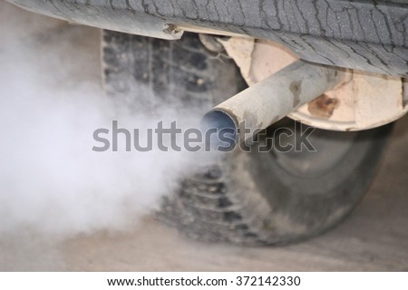 Smoke from car pipe exhaust. Old dirty car