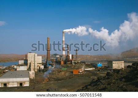 Smoke from factory chimney in an industrial plant.