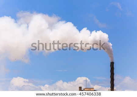 Smoke from factory with blue sky