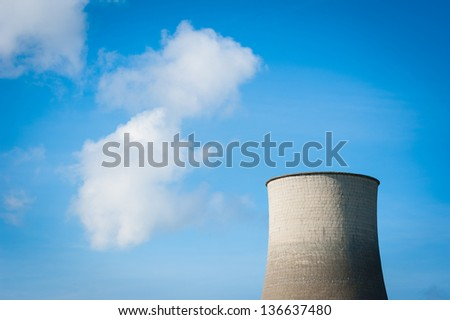 Smoke from industrial chimney on blue sky. - stock photo