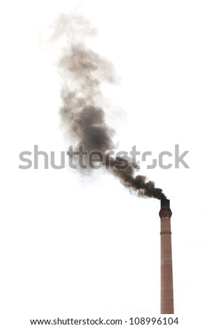 Smoke from smokestack chimney of a traditional rice mill polluting the environment. - stock photo