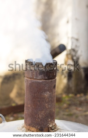 smoke from the chimney fire - stock photo