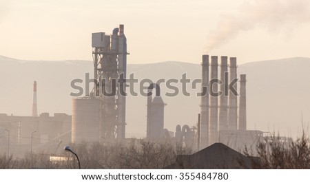 smoke from the chimneys of the plant in nature - stock photo