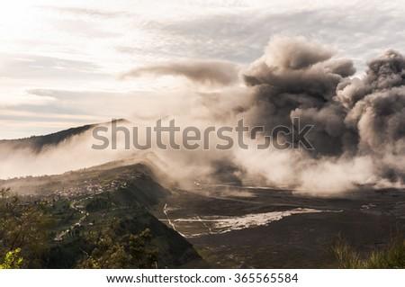 Smoke from the eruption of Bromo volcano above Bromo Tengger caldera,  Java, Indonesia - stock photo