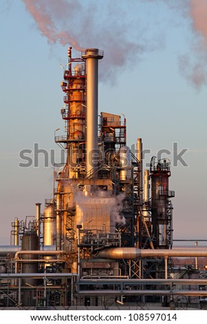 Smoke from the pipes on oil and gas refinery - stock photo