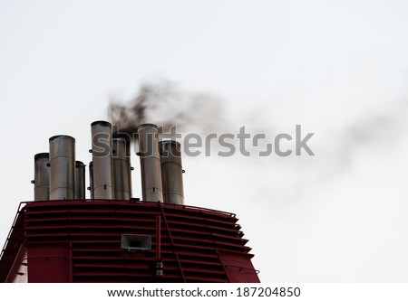 smoke from the ship stacks - stock photo