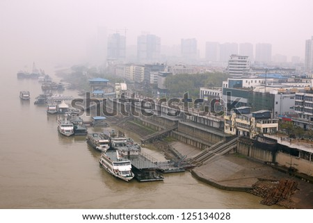 Smoke in the air. Wuhan, China - stock photo