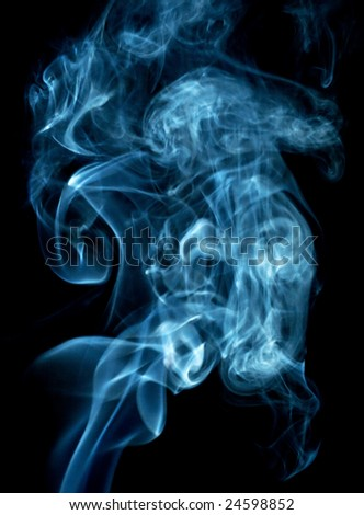 Smoke in the dark. Evil, fire, smoke, cigarette, gas, isolated, twirl, abstract, background. Stock photo.
