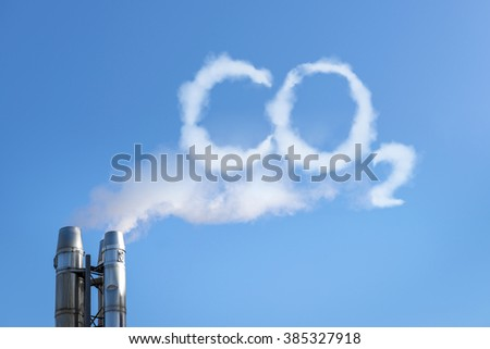 Smoke of chimney writing CO2 in the sky - stock photo