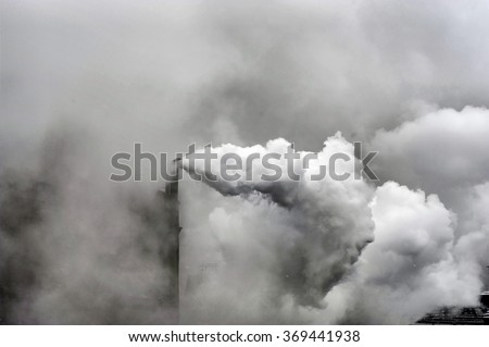 Smoke of heavy industry is highlighted - stock photo