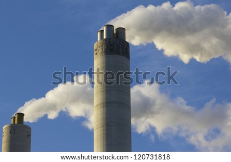 Smoke originating from a large factory - stock photo