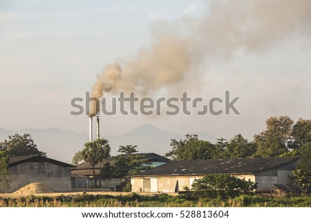 Smoke rising from an industrial food factory in the morning light