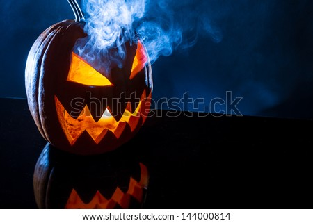 Smoke rising from the pumpkin for halloween - stock photo