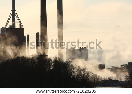 Smoke stack coming from a manufacturing plant - stock photo