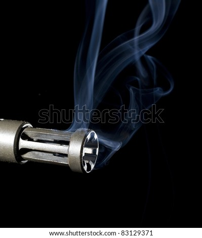 smoke that is rising from an assault weapons barrel - stock photo