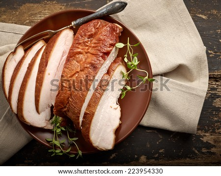 smoked chicken meat on wooden table - stock photo